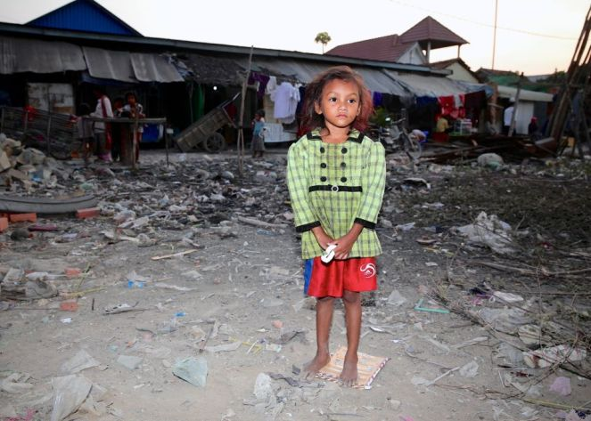 Photo by Scott Neeson of Cambodian Children's Fund. This little girl lives in a village outside the former Stung Meanchey dump site.